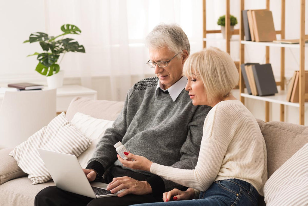 Photo of an older couple shopping for turmeric curcumin online