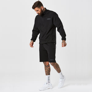 Male Model In 1/2 Zip Track Top From The Mens Full Tracksuit and Matching Shorts