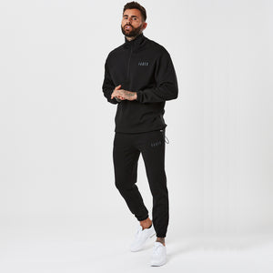 Model in Mens Full Black Poly Tracksuit