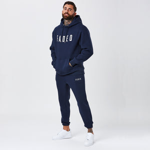 Male Model Wearing Classic Logo Tracksuit in Navy