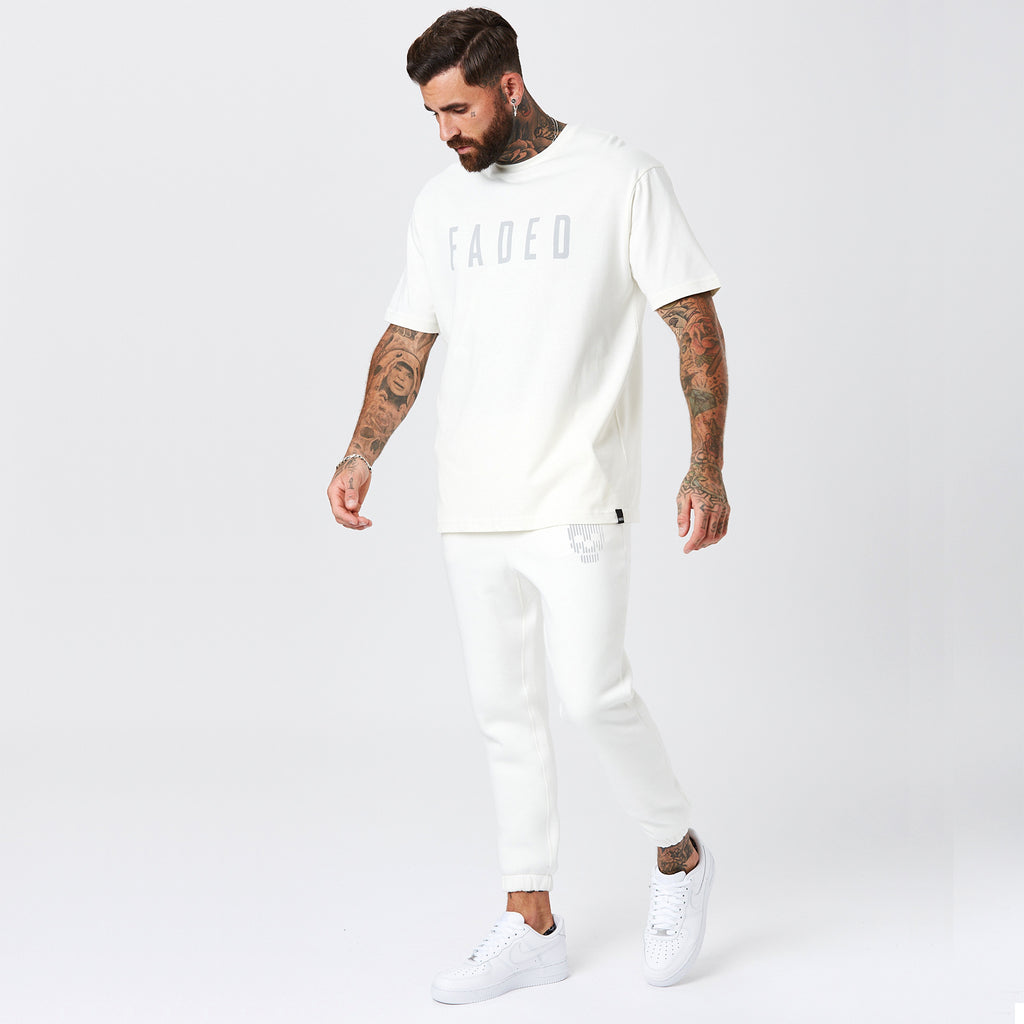 Model Wearing Mens Off-White Skull Logo Joggers and Branded T-Shirt