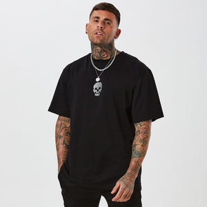 Oversized t-shirt in black with small central skull graphic