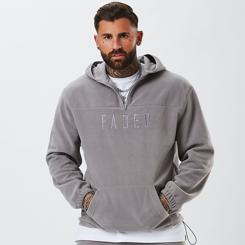 Model Wearing Grey 1/4 Zip Hoody From Mens Full Polar Fleece Tracksuit