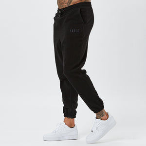 Male Model Wearing Black Joggers From Mens Full Polar Fleece Tracksuit