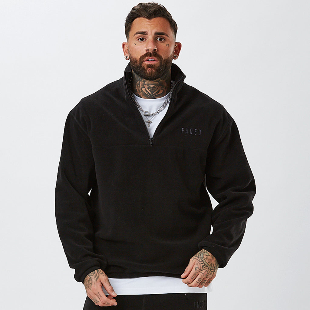 Male Model In Black 1/4 Zip From Full Polar Fleece Tracksuit