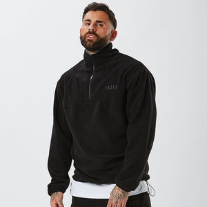 Male Model Wearing 1/4 Zip From Mens Full Polar Fleece Tracksuit in Black