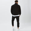 Back View of Model In Mens Full Black Polar Fleece Tracksuit