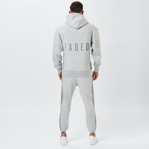 back profile of tonal panelled tracksuit with faded logo
