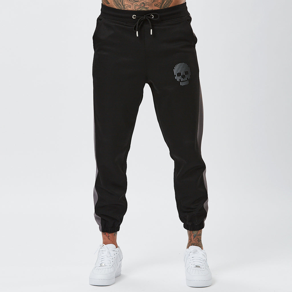 Model Wearing Mens Branded Joggers with Skull Detail From Poly Panel Full Tracksuit