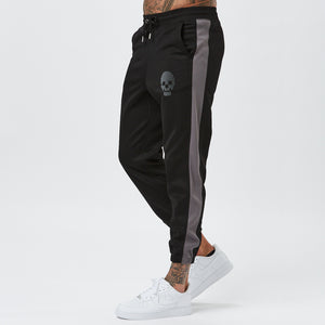 Male Model Wearing Black Mens Joggers With Grey Stripe From Mens Poly Tracksuit