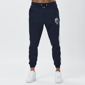 Model In Mens Joggers with Skull Detail From Navy Poly Tracksuit