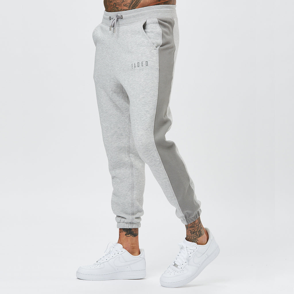 model wearing mens branded joggers with grey panelling