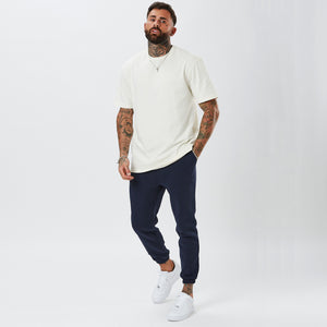 Model Wearing Mens Plain Navy Joggers with White T-Shirt