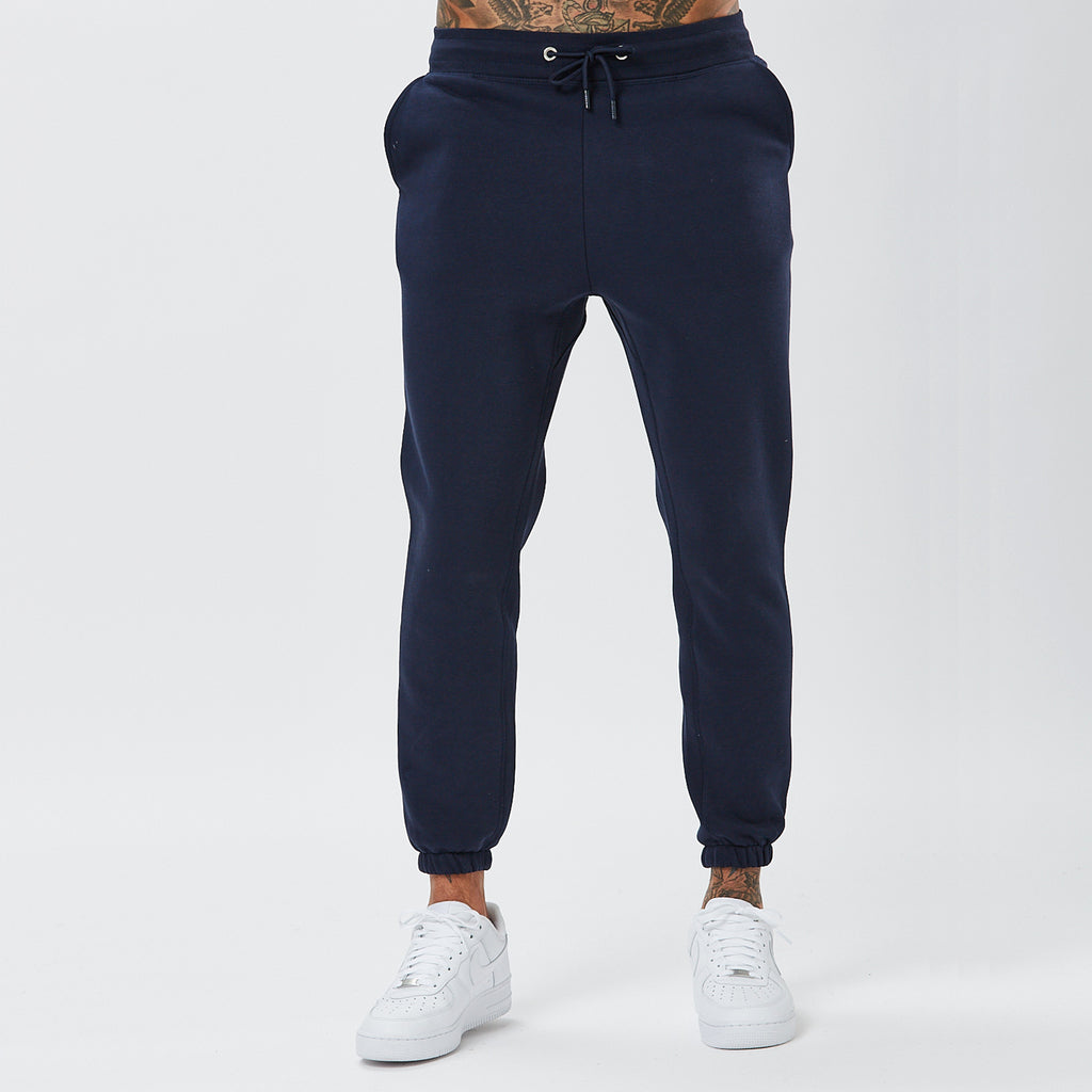 Front View of Male Model Wearing Joggers From The Navy Plain Tracksuit