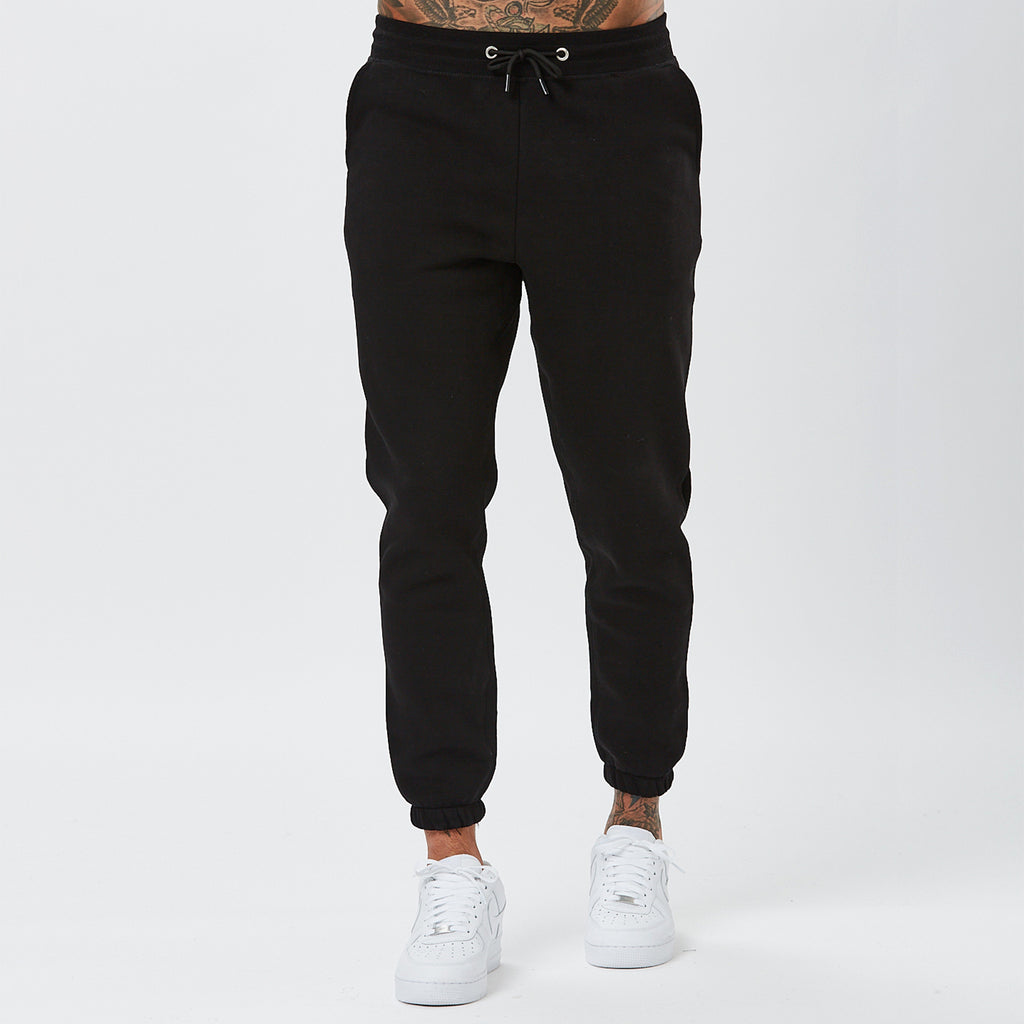 Front View of Model Wearing Mens Plain Black Joggers