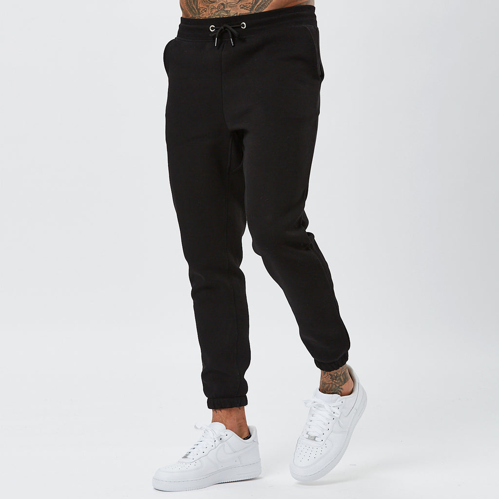 Model Wearing Mens Plain Joggers in Black