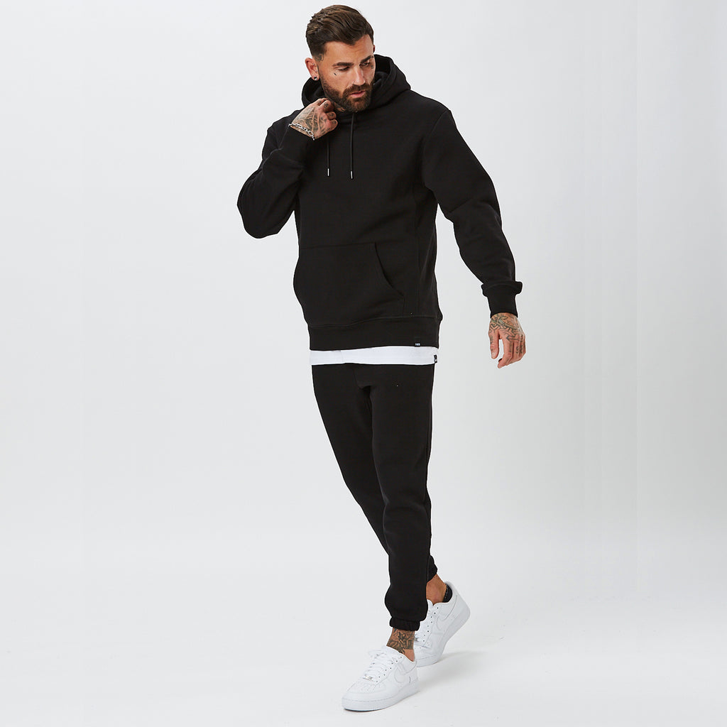 Male Model Wearing Full Black Plain Tracksuit