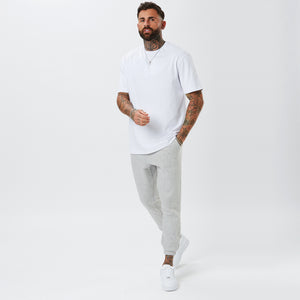 Male Model In Plain Grey Joggers and White T-Shirt