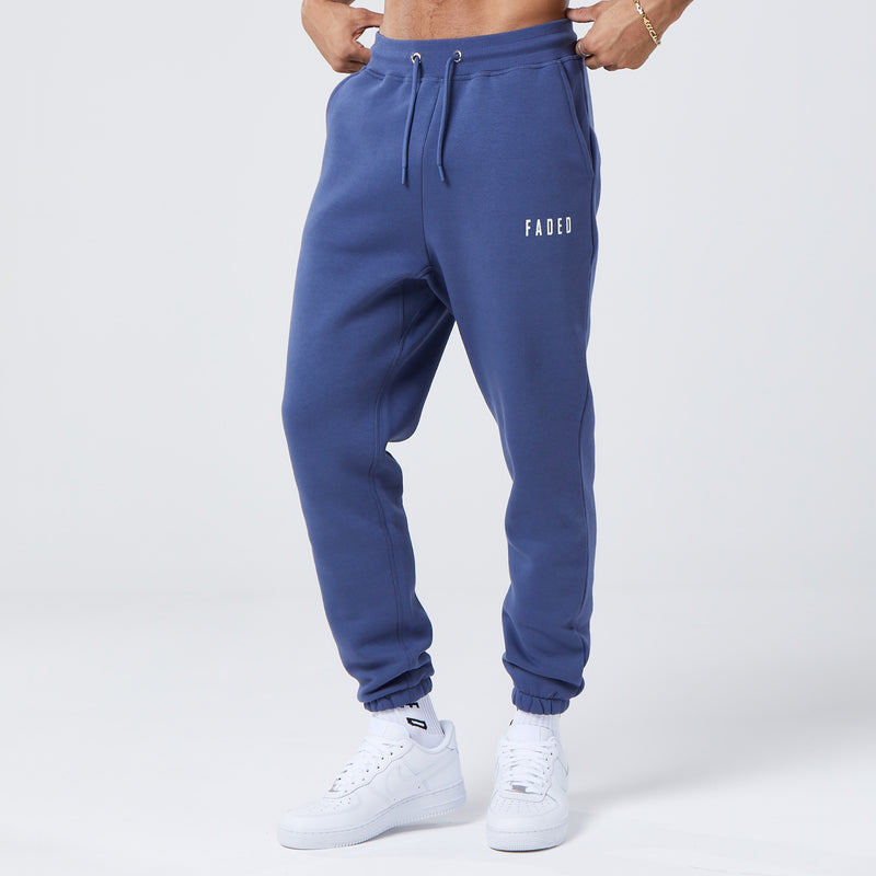 male model wearing dark blue mens branded joggers
