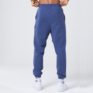 back profile of dark blue mens joggers