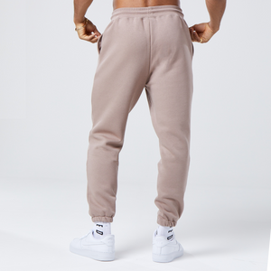 back profile of brown coloured faded joggers