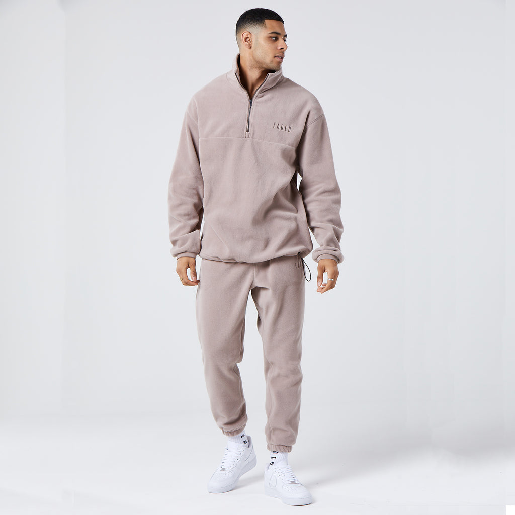 male model wearing mens full tracksuit in brown fleece material