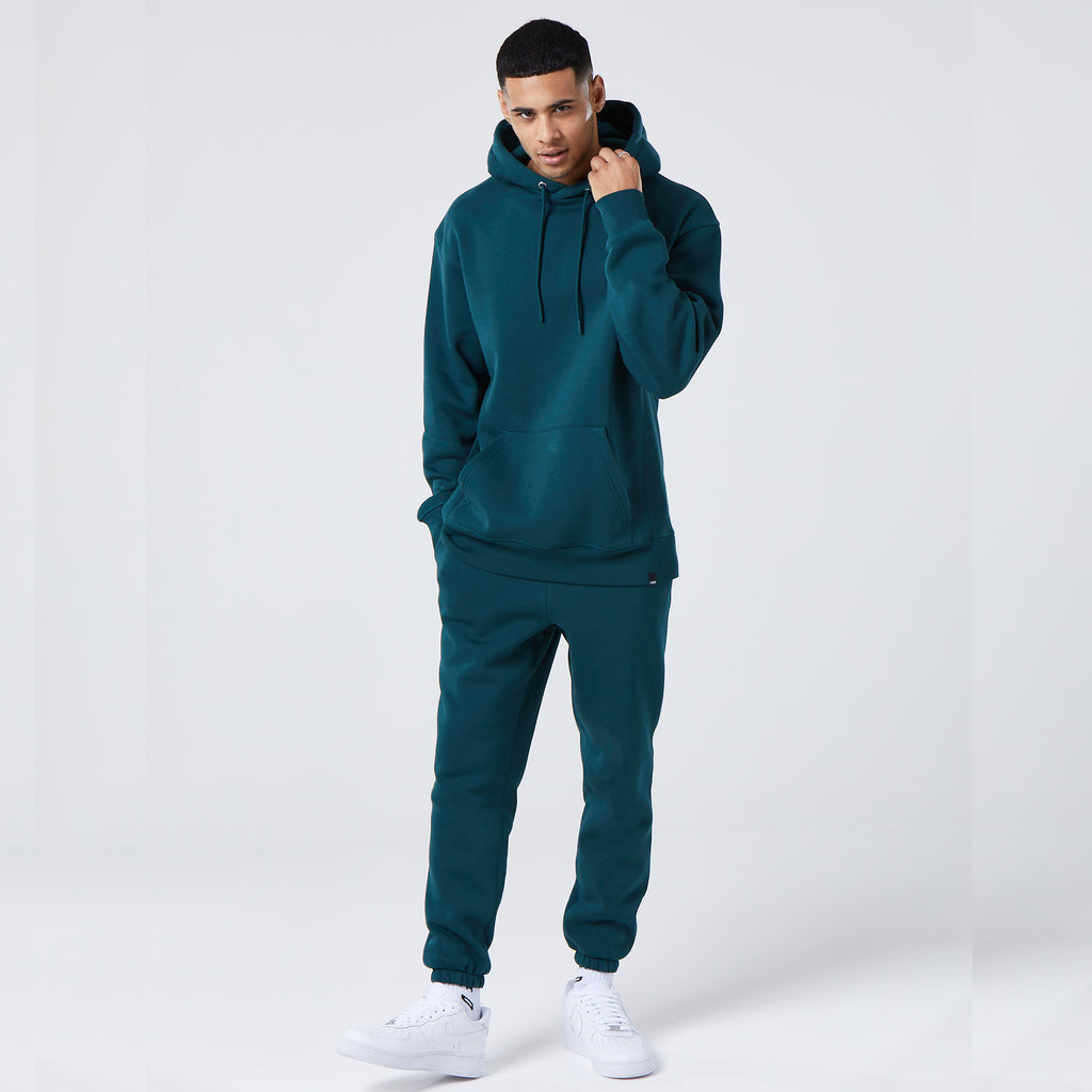 mens plain tracksuit in green worn by male model