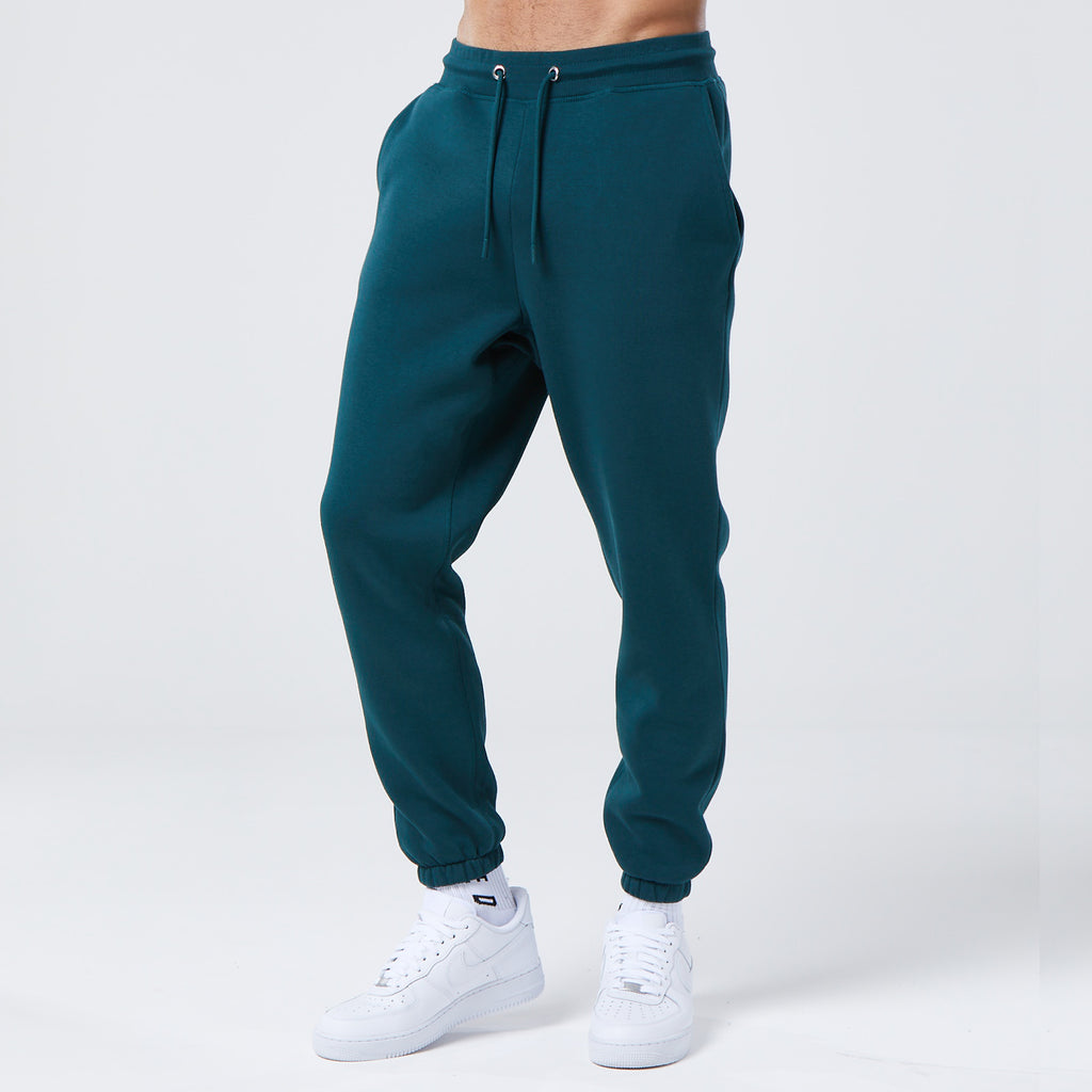 front profile of male model wearing basic green joggers