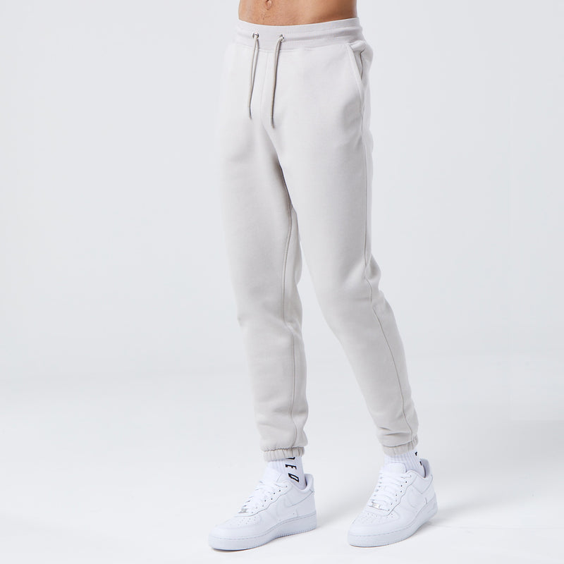 male model wearing mens basic joggers in light grey