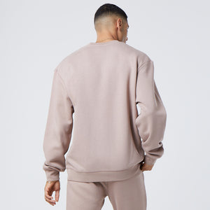 back profile of male model wearing brown faded jumper