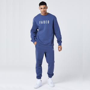 male model wearing mens full tracksuit in dark blue