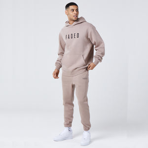 male model wearing mens full tracksuit in brown