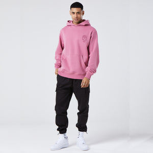 model wearing cherry coloured mens graphic hoodie