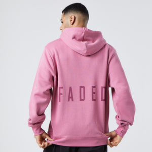 back profile of cherry coloured hoodie with large faded logo