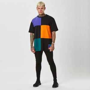 model wearing grid graphic colour t-shirt