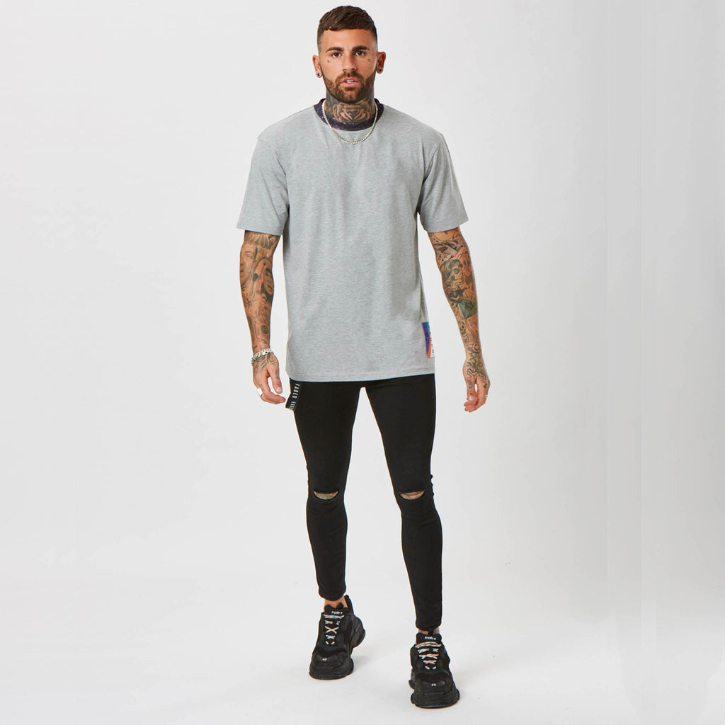 model wearing Faded grey t-shirt & black jeans