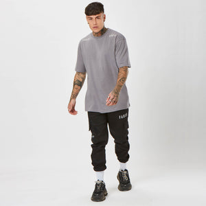 Chet Sket wearing Faded t-shirt and streetwear cargos
