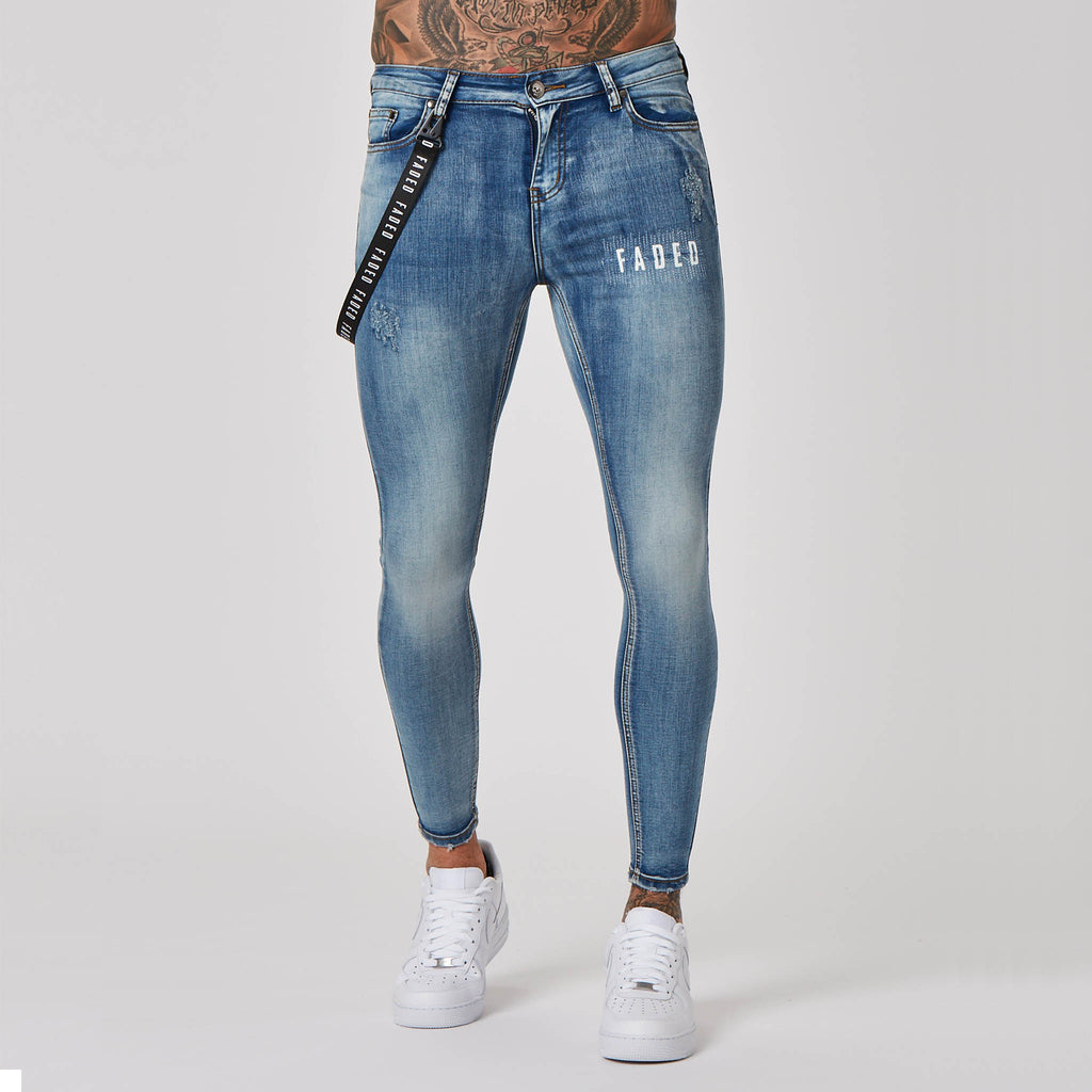 Distressed Logo Spray on Non-Ripped Jeans | Antique Wash