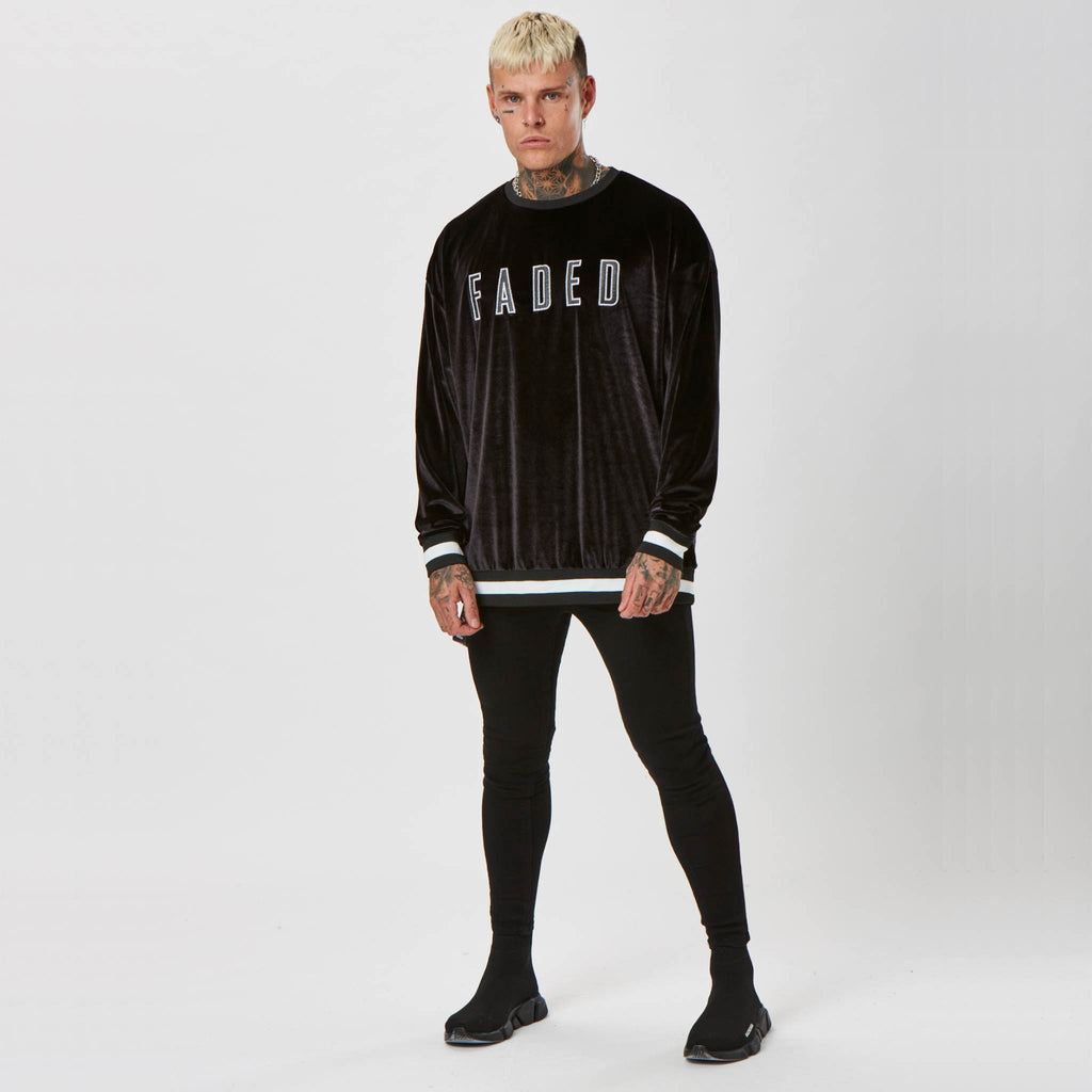 FADED branded velour jumper and black jeans