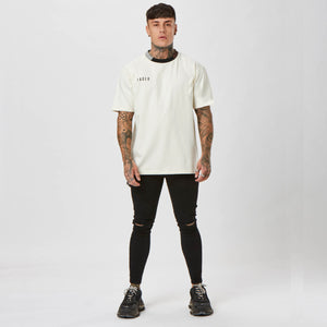 Chet Sket Wearing Faded Ecru Trio Ringer