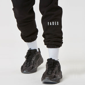 Shin detail on mens branded joggers in black