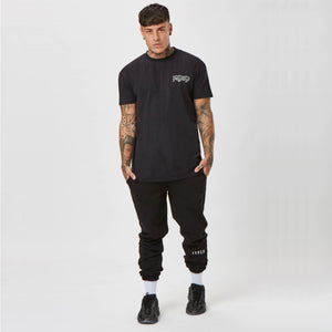 Chet Sket wearing Faded streetwear top and joggers