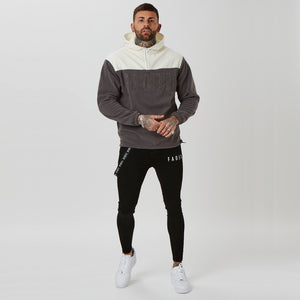 Teddy fleece branded hoodie and black skinny jeans