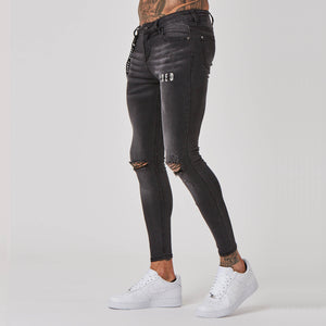 Faded branded grey spray on jeans