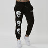 Branded graphic joggers for men with skull detail - black
