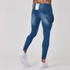 Back view on mens spray on blue jeans
