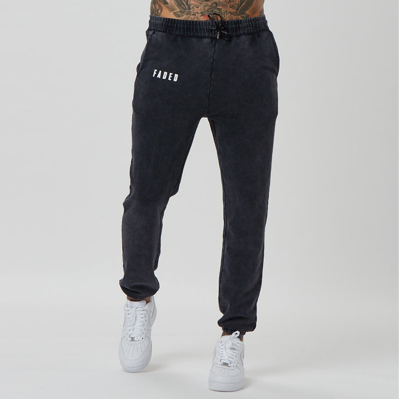 back shot of branded mens joggers in acid wash