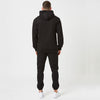 Fit detail on mens black hoodie and shin jogger