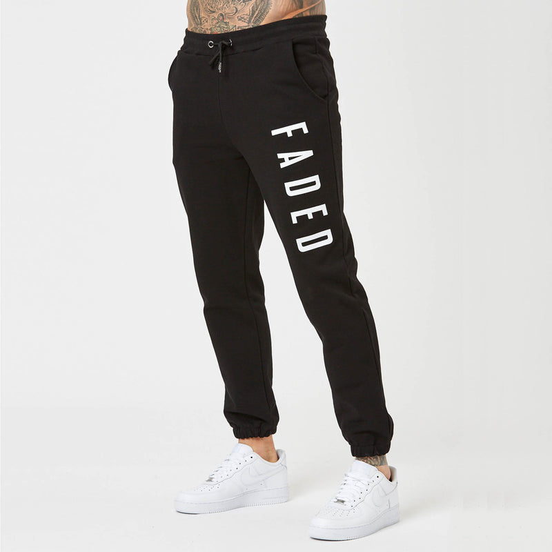 fit detail on mens branded joggers and hoodie in black
