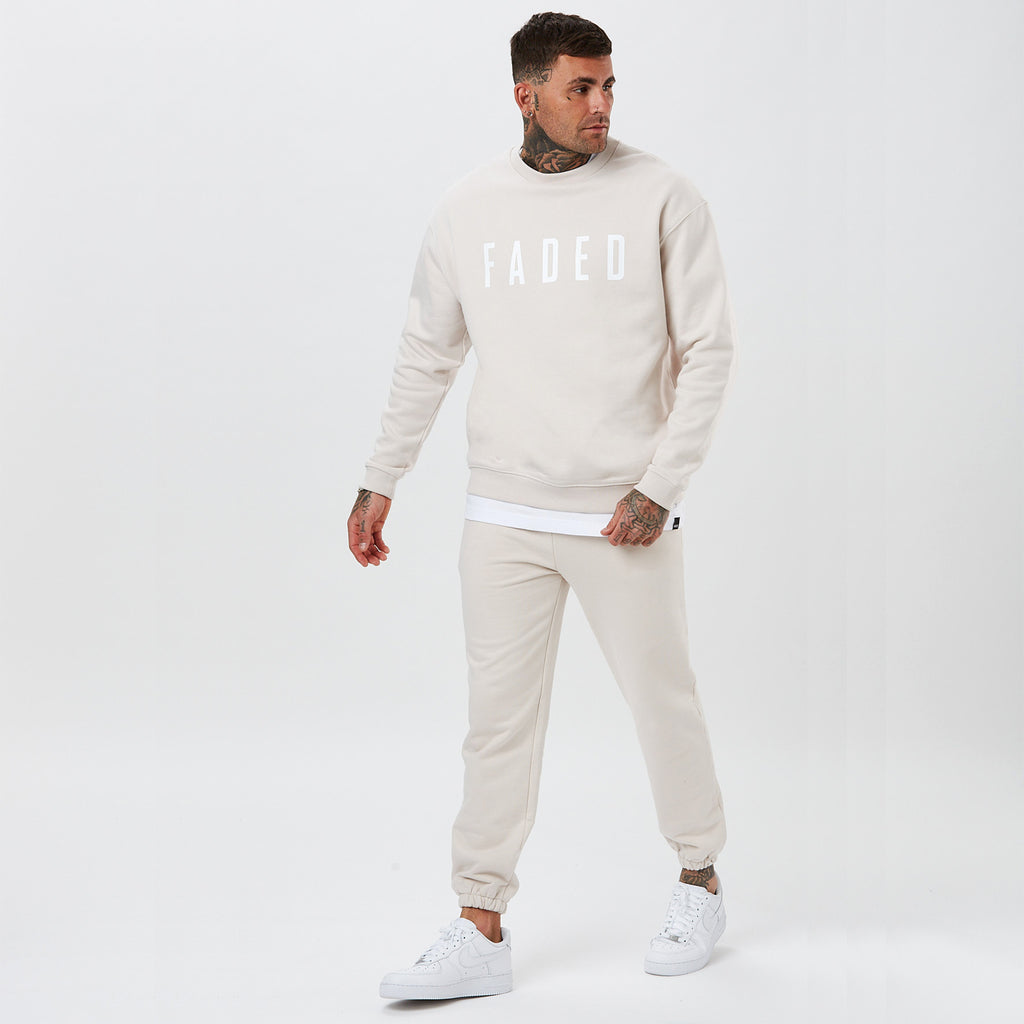model wearing ecru coloured heavyweight small logo tracksuit